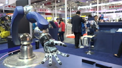 Mechanical bionic arm, robotics trade show, moving fingers, China, Asia Stock Footage