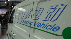 Electric vehicle on display at a trade show in Shanghai, China - stock footage