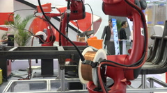 Manufacturing robots on display at an industrial exhibition in Shanghai, China Stock Footage