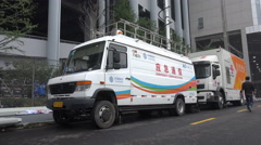 China telecom, mobile technology, emergency units, vehicles, trucks Stock Footage