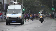 Professional marathon runners lead the race at the Shanghai Marathon in China - stock footage