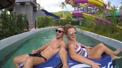 Happy Young Couple in Swimming Pool in Aquapark. 2.7k Stock Footage