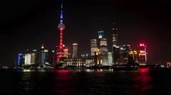 Shanghai night city view with skyscrapers, Oriental Pearl Tower and river. 4K - stock footage