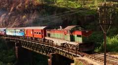 Old train on metal bridge in highlands countryside. Sri Lanka. 4K Stock Footage