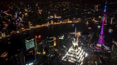 Shanghai night aerial city view with skyscrapers, Oriental Pearl Tower and river Stock Footage