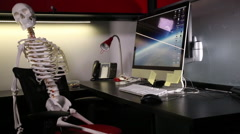 Corpse Died in the Office - Skeleton trapped in a cubicle Stock Footage