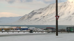 Car passes by the street of  the arctic town of Longyearbyen, Norway. Stock Footage