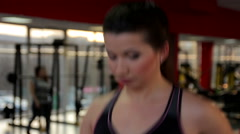 Hot brunette taking care of her fit body, exercising on treadmill in the gym Stock Footage