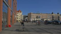 People Sit on a Benches Walk by Ozimska Street Opole Cobblestone Square People Stock Footage