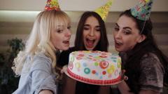 selfie girlfriend bite cake birthday girl - stock footage