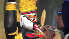 Close shot of an Indian statue maker giving final touch. Stock Footage