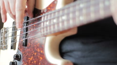 Man with Tatoo playing bass guitar Stock Footage