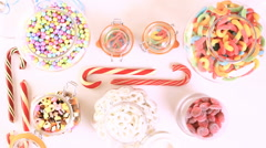 Multicolored candies on a white table. Stock Footage