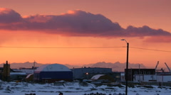 View to the buildings of arctic town at sunset in Longyearbyen, Norway. Stock Footage