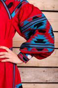 Ukrainian embroidered female folk costume  background wood - stock photo