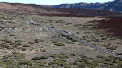 Crossing of TF-21 road and turn to lower station of Teide cable car. Tenerife Stock Footage