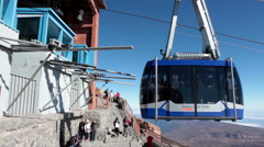 Blue cabin of cable car comes to upper terminal of Teide Teleferico. Tenerife Stock Footage