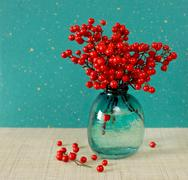 Japanese vase with red berries of Sacred Bamboo (Nandina Domestica) Stock Photos
