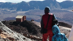 Family of three people are on rocky path on southeast slope, Teide, Tenerife Stock Footage