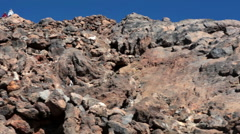 Hiking trail to the crater of Teide with hikers standing on altitude, Tenerife Stock Footage
