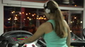 Young female wearing earphones switches off treadmill, finishes workout in gym HD Footage