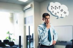 Businessman doing mental arithmetic Stock Photos