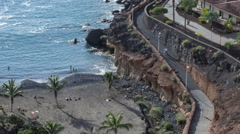 Camera moving along pathway at ocean coast, time lapse. Playa Paraiso, Tenerife Stock Footage