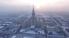 Beautiful frozen WINTER Moscow city cowered in snow and ice, Aerial FPV Drone Stock Footage