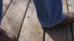 Man walking on a boardwalk trail - stock footage