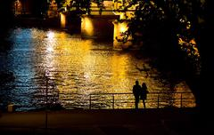Couple Silhouette Near the River at Night Stock Photos