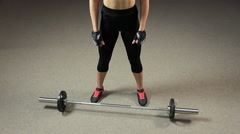 Motivated strong female athlete preparing to lift heavy barbell, weightlifting Stock Footage