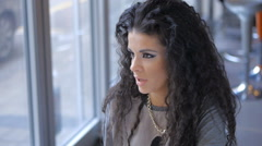 Beautiful curly, black hair girl enjoying happy time in cafe Stock Footage