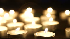 Burning candles on a table Stock Footage