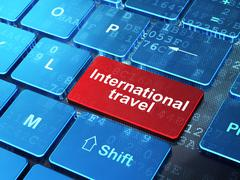 Travel concept: International Travel on computer keyboard background - stock illustration