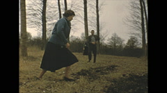 Vintage 16mm film, 1955, France, people and dog in the woods Stock Footage