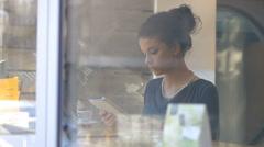 Businesswoman on coffee breake, reading tablet, drinking coffe Stock Footage