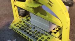 Machine cutting cement block Stock Footage