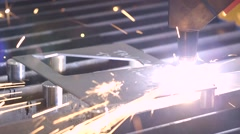Robotic arm cutting through plate of steel Stock Footage
