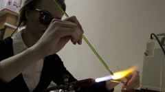 Woman making glass bead - stock footage