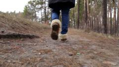 A girl walks through the woods. slow-motion pictures Stock Footage