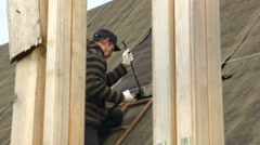 Man Midle Age in the Eyeglasses in the Country Repairing a Roof Day Autumn, Stock Footage
