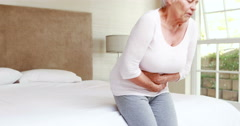 Senior woman having a stomachache Stock Footage