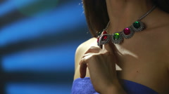 necklace on the neck. ruby and emerald - stock footage