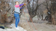 Girl-climber works with Gris Gris on the rope system Stock Footage