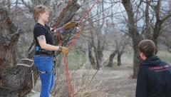 Girl pulls a rope system under the supervision of an instructor Stock Footage