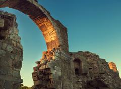 Side archway ruins in sunset time - stock photo