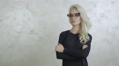 Stock Video Footage of Beautiful Young Blonde Woman with Glasses 1