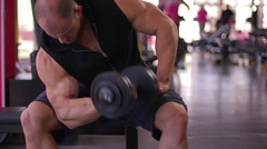 Muscular man enjoying workout in gym, proud of his results, bodybuilder training Stock Footage