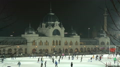 Tourists and locals ice skating on Christmas in the City Park of Budapest Stock Footage