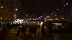 People walking by a nativity scene in Szent Istvan Square on Christmas, Budapest Stock Footage